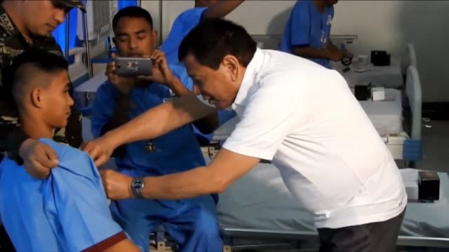 Philippine President Rodrigo Duterte visits wounded soldiers in Jolo Sulu a day after he made jokes about rape saying he would congratulate a rapist...