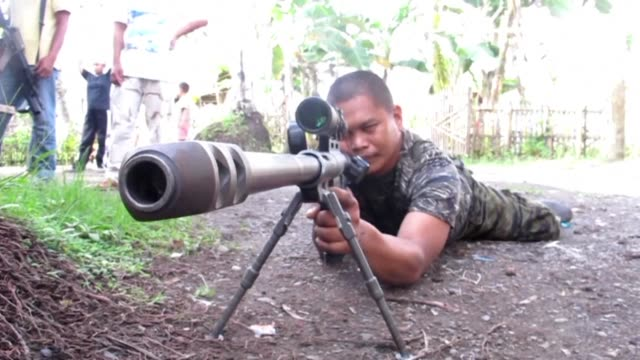 Philippine President Rodrigo Duterte warns that martial law will be harsh and like a dictatorship after imposing military rule in the south of the...