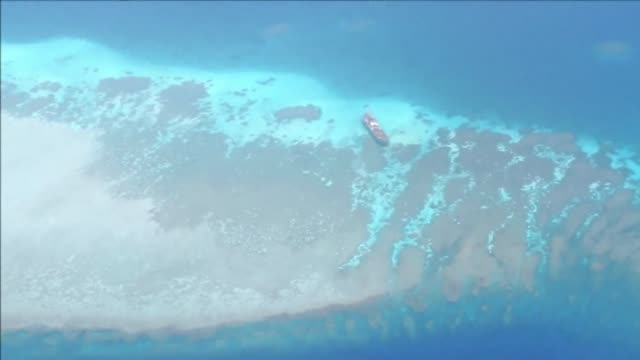 a philippine re supply ship evaded a chinese coastguard blockade in the south china sea saturday to reach filipino soldiers based on a remote reef... - south china sea stock videos & royalty-free footage