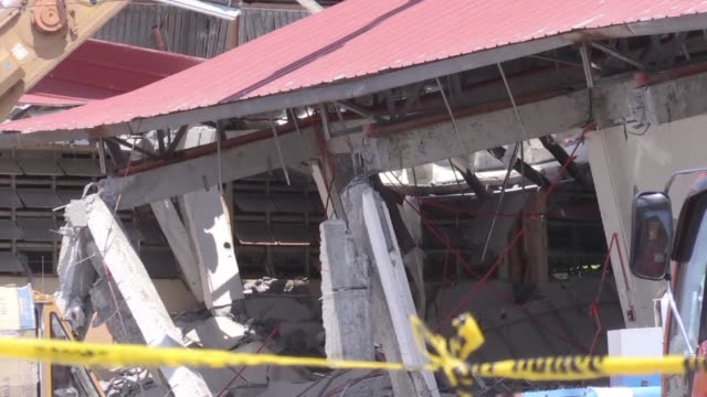 philippine rescuers scramble to reach dozens of people feared buried under a building near manila that collapsed a day earlier in a powerful... - damaged stock videos & royalty-free footage