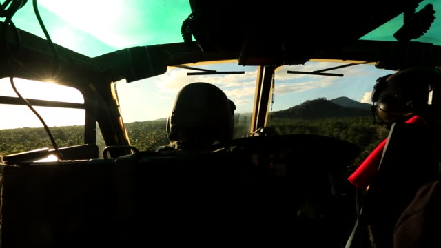 philippines army soldiers in a helicopter flying over sulu - aircraft point of view stock videos & royalty-free footage