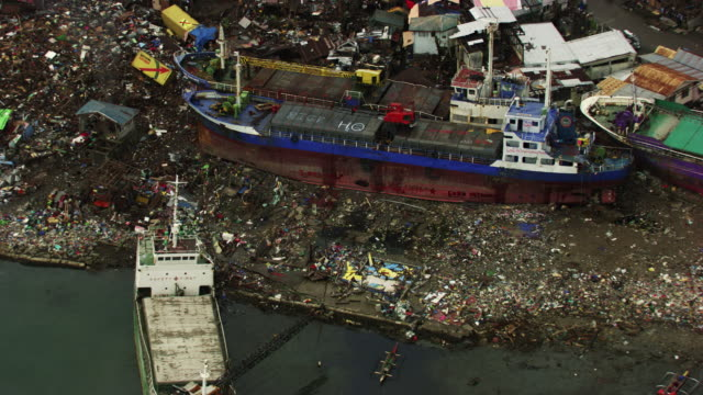 philippines: beached boats - typhoon stock videos and b-roll footage