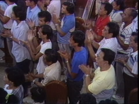 stockvideo's en b-roll-footage met philippines election campaign; philippines: manila: painting of assassinated opposition leader benigno aquino being held by the virgin mary aquino's... - crime and murder