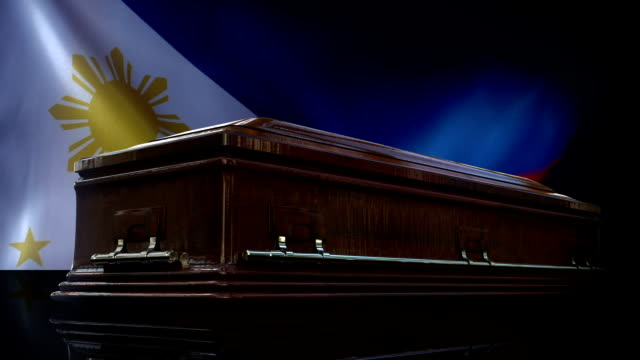 philippines flag behind coffin - philippines flag stock videos & royalty-free footage