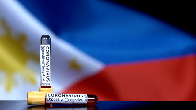 philippines flag flapping behind the blood test tubes - philippines flag stock videos & royalty-free footage