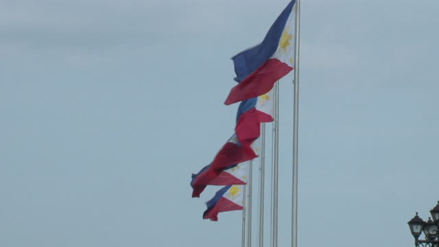 ms philippines flags blowing against sky / mindoro, philippines - philippines flag stock videos & royalty-free footage