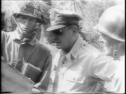 philippines/ general douglas macarthur arrives after san manuel has fallen / shakes hands with his men confers with soldiers at a map / washington dc... - william halsey stock-videos und b-roll-filmmaterial
