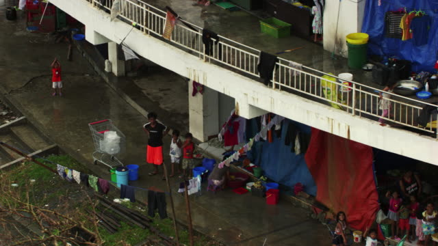 philippines: tacloban city refugee centre - crisis stock videos & royalty-free footage