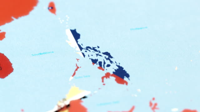 philippines with national flag on world map - philippines flag stock videos & royalty-free footage