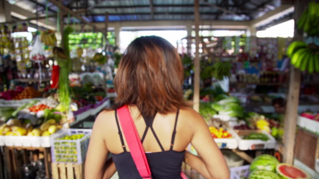 philippines. young woman buying at vegetables market - gewürz stock-videos und b-roll-filmmaterial
