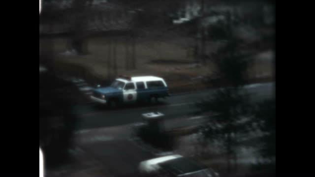 philly neighborhood from a home movie archive / a police wagon briefly passes by. - philadelphia pennsylvania bildbanksvideor och videomaterial från bakom kulisserna