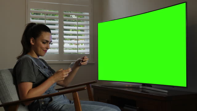 Phone card pay, TV chromakey. Young woman.