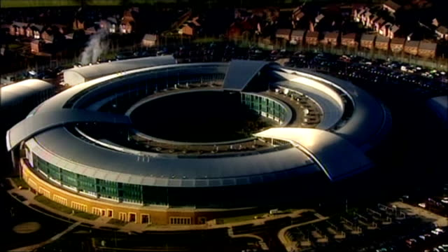 phone companies demand answers over us tracking of text messages lib cheltenham gchq air view government communications headquarters building - gloucestershire stock videos and b-roll footage
