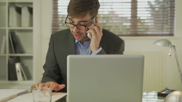 phone enquiry, office worker. - button down shirt stock videos & royalty-free footage