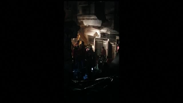 phone footage shows rescue workers working through the night, searching through debris, after a plane with nearly 100 people on board crashed in the... - aerospace stock videos & royalty-free footage