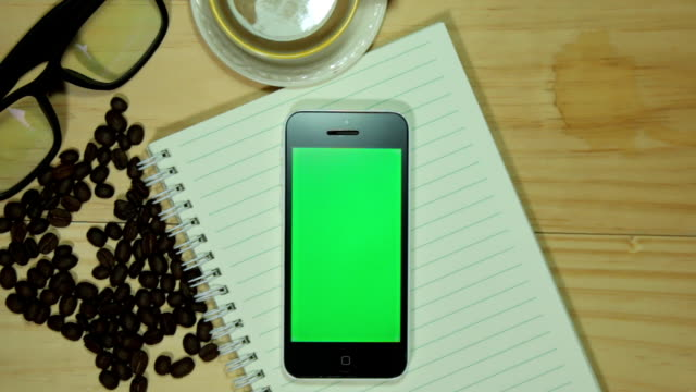 phone green screen on rustic table portrait - table top shot stock videos & royalty-free footage