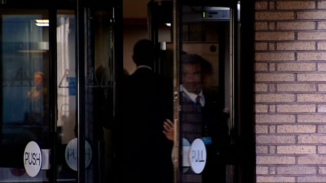 Andy Coulson and Rebekah Brooks arrive at court ENGLAND London Southwark Crown Court EXT Andy Coulson arriving at court / unidentified people...