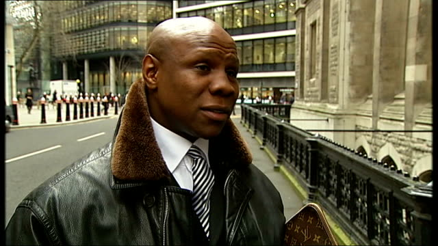 chris eubank rejects news internatinal compensation offer; england: london: high court: ext chris eubank interview sot - re why he turned down... - chris eubank sr stock videos & royalty-free footage