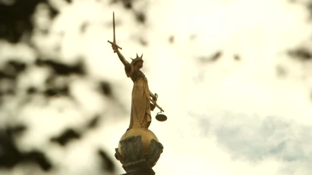 cps to stop criminal investigations t24061408 / 2462014 london ext various of statue of justice atop the old bailey - statue of justice london stock videos and b-roll footage