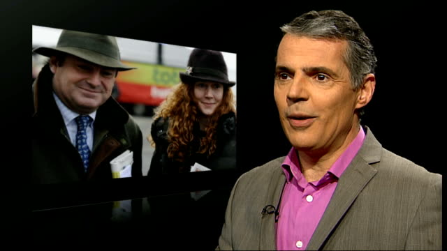 rebekah brooks and husband arrested int peter jukes interview sot with still of rebekah brooks and husband in background - レベッカ ブルックス点の映像素材/bロール