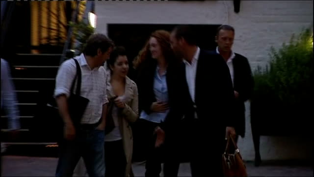 rebekah brooks and husband arrested tx 1072011 london brooks husband charlie brooks and james murdoch towards from restaurant with others ends - レベッカ ブルックス点の映像素材/bロール