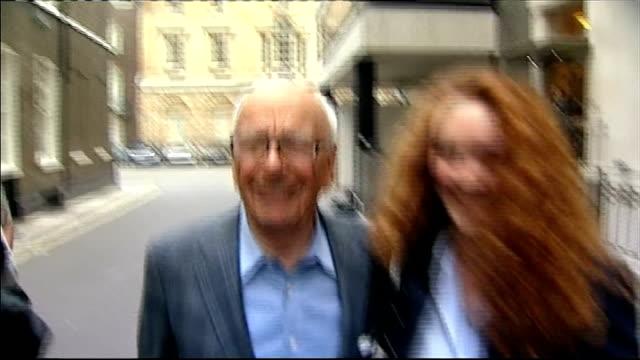 rebekah brooks and husband arrested tx london photography**** rupert murdoch towards through press scrum next rebekah brooks - rupert murdoch stock videos and b-roll footage