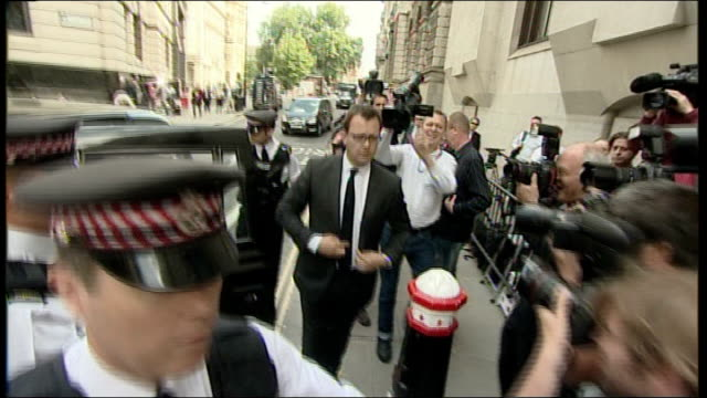 andy coulson sentenced to 18 months england london old bailey ext andy coulson from taxi and through throng of press photographers into court - andy coulson stock videos & royalty-free footage