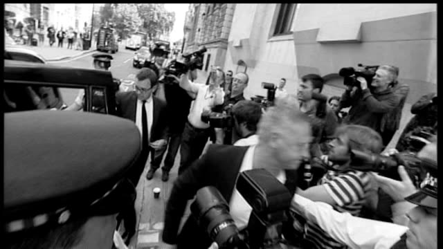 andy coulson sentenced to 18 months; old bailey: ext b/w graphicised slow motion shot coulson arriving at court - sentencing stock videos & royalty-free footage