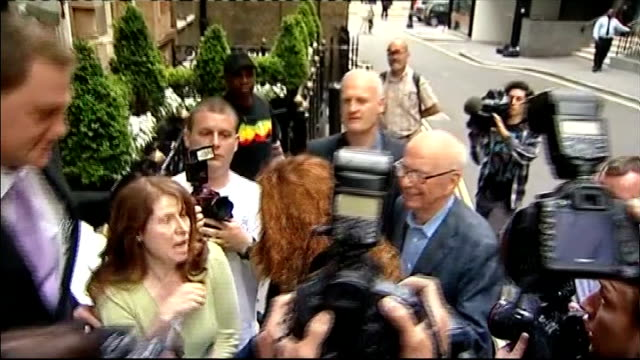 charlie brooks gives evidence 1072011 london rupert murdoch and rebekah brooks through press scrum together as entering building - スクラム点の映像素材/bロール