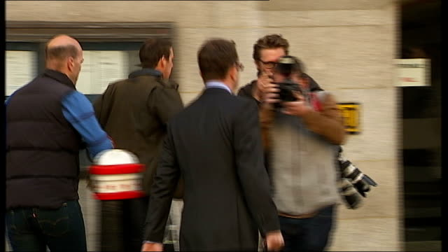 court arrivals Andy Coulson arriving / Rebekah Brooks and husband Charlie Brooks arriving with photographers around