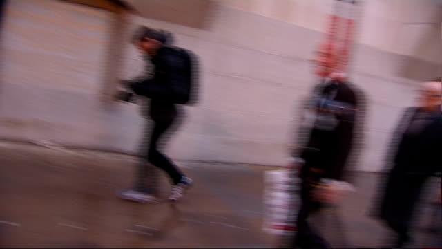 Court departures ENGLAND London Old Bailey PHOTOGRAPHY*** Dan Evans leaving court along past cameras / Andy Coulson departure along past cameras