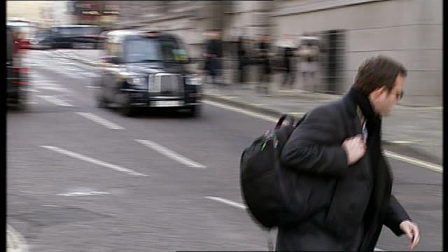 ex journalist dan evans pleads guilty to phone hacking andy coulson along towards court entrance passing press photographers reporter to camera - andy coulson stock videos & royalty-free footage