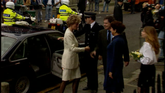 Princess Diana 'gave royal phone book to News of the World' 1992 PHOTOGRAPHY** Diana Princess of Wales from car and shaking hands as arriving at...