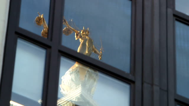 rebekah brooks gives evidence in her defence lady justice reflected in office windows 'central criminal court' sign - lady justice stock videos and b-roll footage