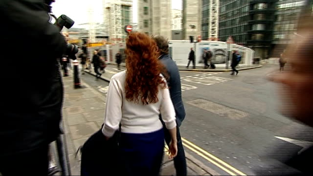 rebekah brooks gives evidence in her defence england london old bailey ext rebekah brooks and charlie brooks getting out of taxi towards and along... - statue of justice london stock videos and b-roll footage
