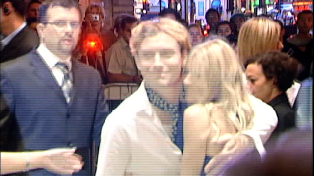 sienna miller gives evidence r02070522 / 272005 regent street jude law and sienna miller posing at cafe royal for live8 after show party - cafe royal stock videos and b-roll footage