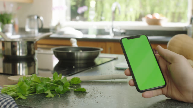 phone in kitchen - kitchen worktop stock videos & royalty-free footage