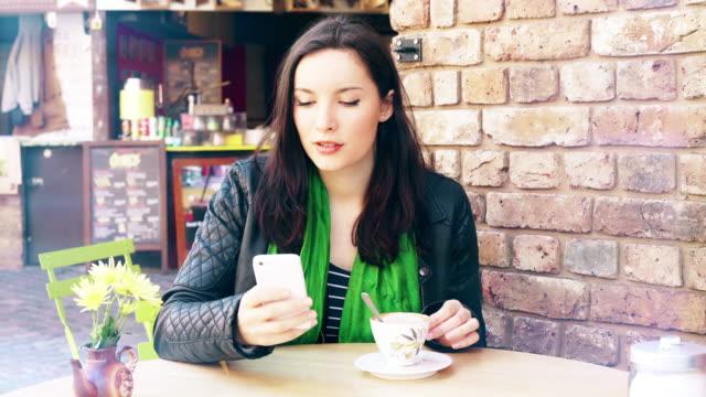 Phone message. Sidewalk cafe, coffee.