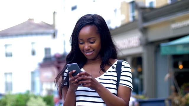 phone message smile. - text messaging stock videos & royalty-free footage