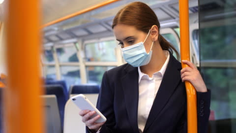 phone message, virus protected travel travel. young woman commuter. - businesswear stock videos & royalty-free footage