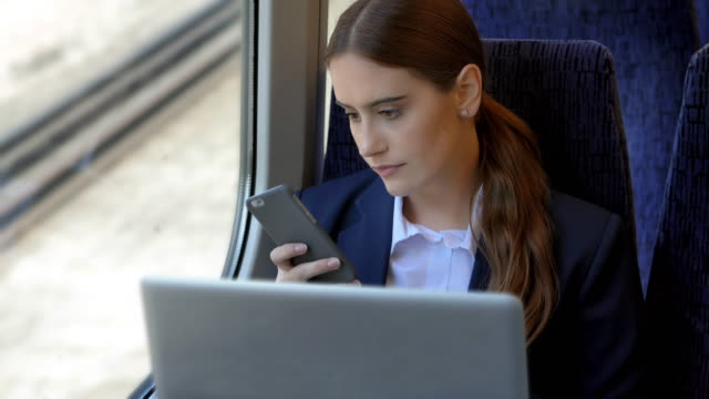 phone message working using laptop on a train. - phone message stock videos & royalty-free footage