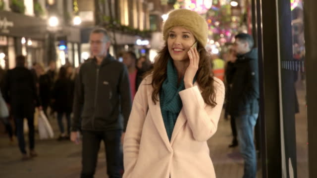 phone night street - christmas shopping stock videos and b-roll footage