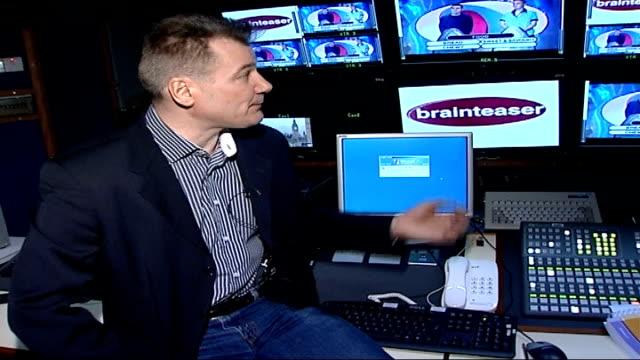 vidéos et rushes de phone quiz scandal continues as channel five suspends quiz show; england: london: int reporter to camera in edit suite with 'brianteaser' quiz show... - jeu télévisé