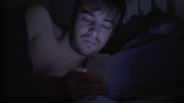 phone text message, in bed. broken sleep. 3 - phone message stock videos & royalty-free footage