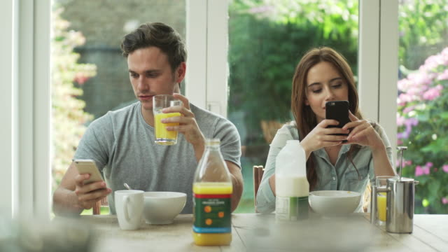 phones at breakfast - text stock videos & royalty-free footage