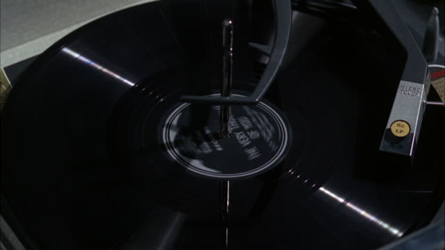 cu phonograph record on revolving platter / los angeles, california, united states - deck stock videos & royalty-free footage