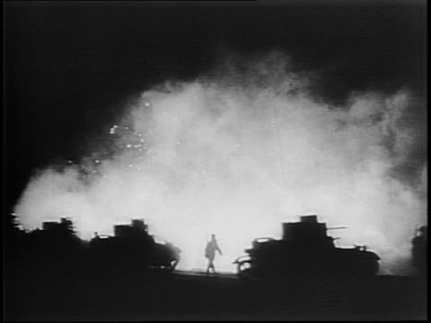 phosphorous explosion in the night / soldiers on a beach and artillery guns firing in the night / firefight illuminating the dark / soldiers' faces... - newsreel stock videos & royalty-free footage