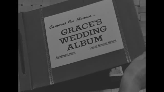 Photo album titled ïCameras on MonacoƒGraceÍs Wedding AlbumÍ hand turns pages CU Black and white photos of KellyÍs wedding to Prince Rainier III...