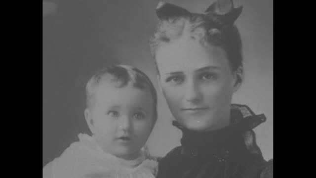 alice warfield holds baby daughter wallis simpson on lap / ms ext christ protestant episcopal church in baltimore where simpson married her first... - 退位点の映像素材/bロール