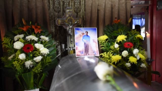 a photo and a flower sit on the coffin of julio valdivia a journalist who was found decapitated in a violenceplagued area of eastern mexico as... - decapitated stock videos & royalty-free footage